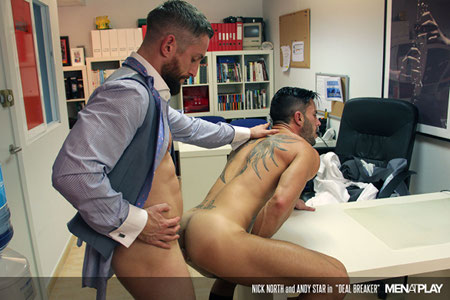 Muscular men in suits fucking in an office.
