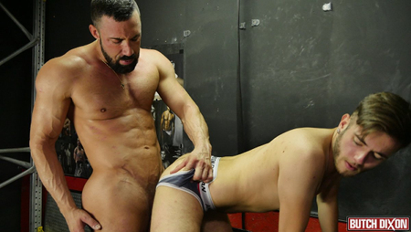 Giant muscle Daddy fucking a twink through his ass-less boxer jock.