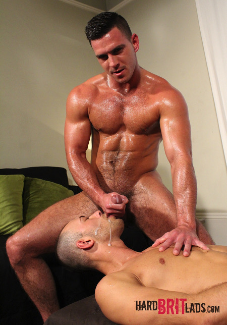 Hairy muscle stud ejaculating on the face of another man.