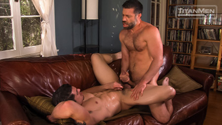 Muscular Daddy shooting a giant cum fountain on his muscle bottom boy.