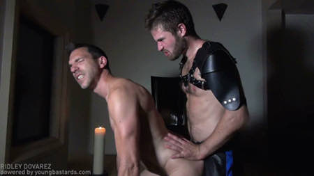 Gay slave fucked bareback by his gay master doggy-style.