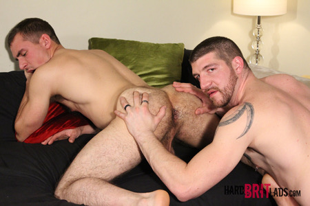 Muscular hunk eating the hairy ass of another man.