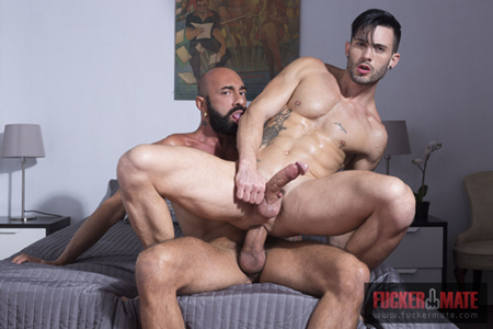 Tattooed muscle stud sitting on a raw uncut monster cock.