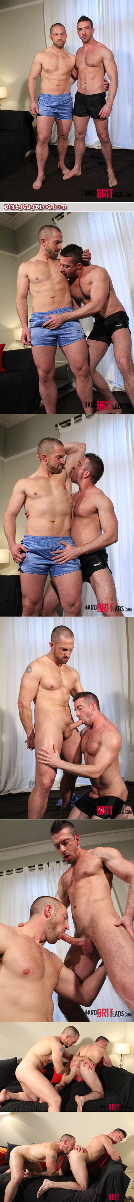Scruffy muscle hunks in silky sports shorts having gay sex.