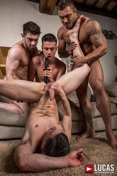 Four guys playing with a huge dildo and making someone cum.