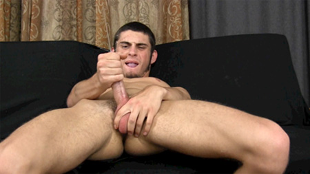 Masturbating twink sprays his cum everywhere when he ejaculates.