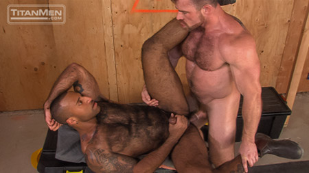 Hairy bodybuilders having gay anal sex at a construction site.