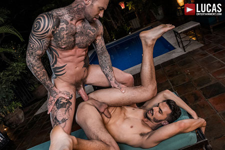 Heavily tattooed bodybuilder fucking another man with his big dick.
