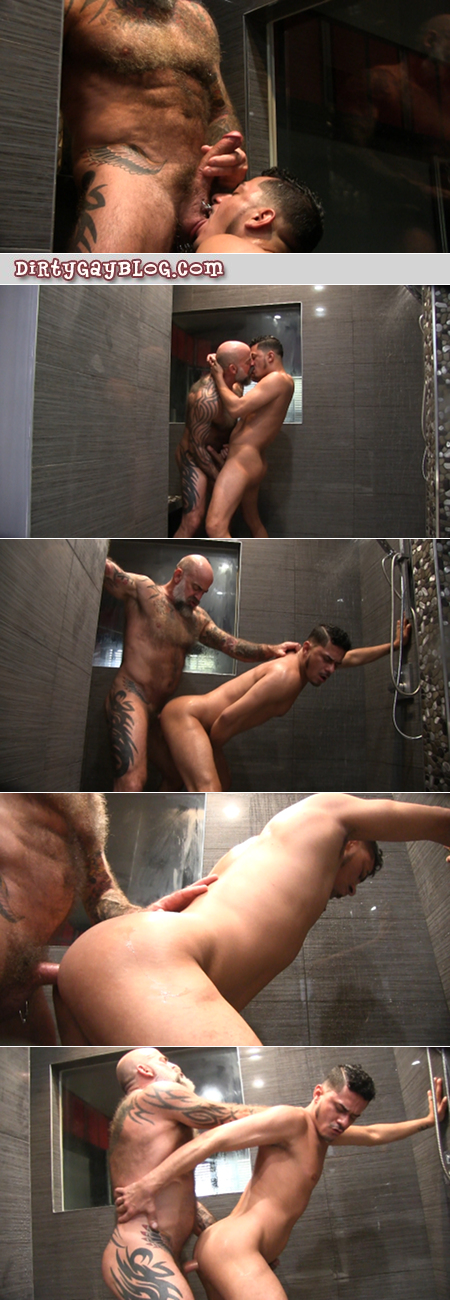 Hairy muscle Daddy fucking a hung Latino man bareback in the shower.