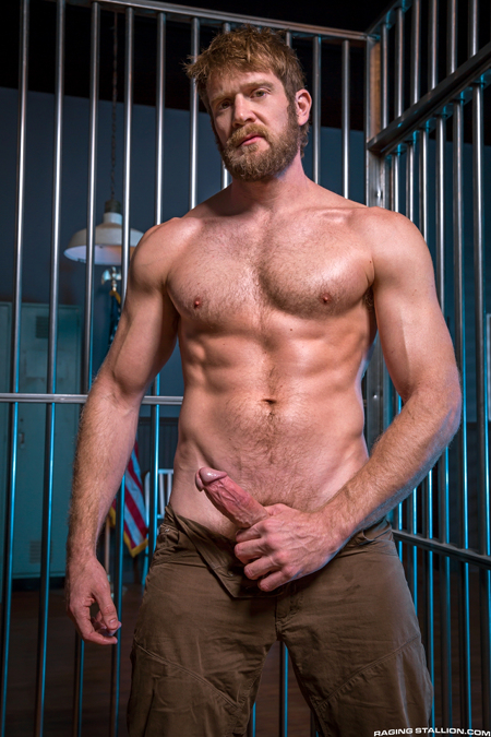 Hairy, muscular ginger sporting an erection in jail.