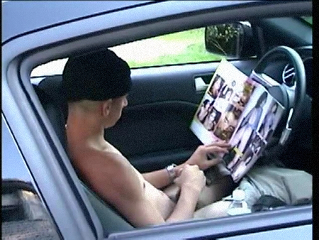 Straight boy jacking off in his car to a porno magazine.