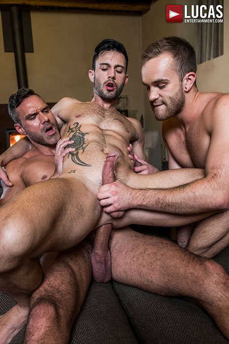 Gay muscle hunk cumming while two men stroke and fuck him bareback.