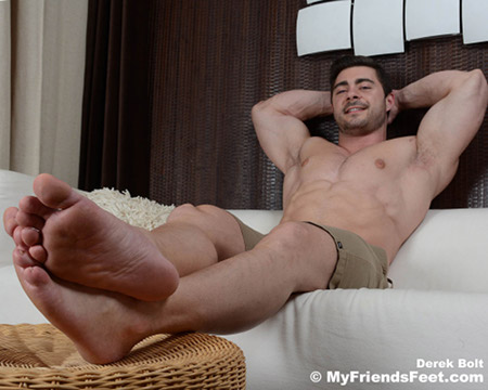 Muscular bodybuilder showing off his thick, size 9 bare feet.