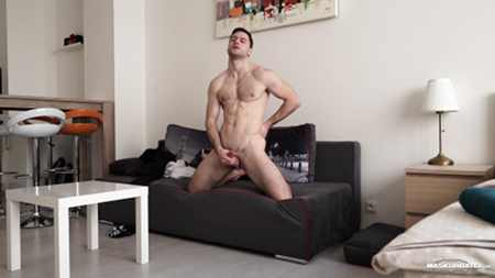 Eastern European man masturbating on the couch.