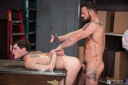 Tattooed muscle stud fucking a bound boy in the ass.