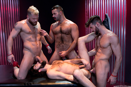 Hairy, muscular men having gay group sex together.