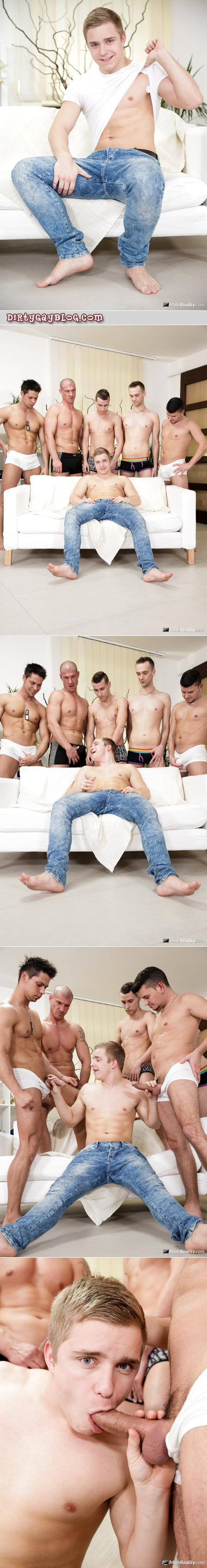 Young man sucking multiple dicks in a gay group sex scene.