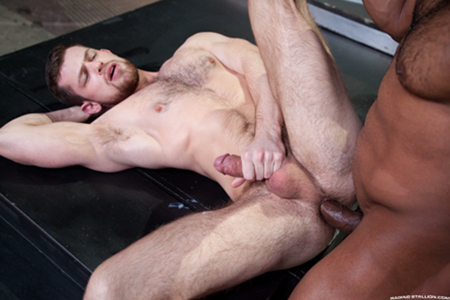 Hairy muscle jock taking a big black cock in his ass.