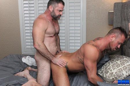 Muscle bear fucking a gay muscle stud bareback.