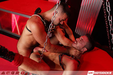 Gay leather Daddy choking a power bottom while he fucks him in the ass.