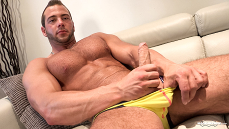 French bodybuilder stroking his veiny uncut cock.