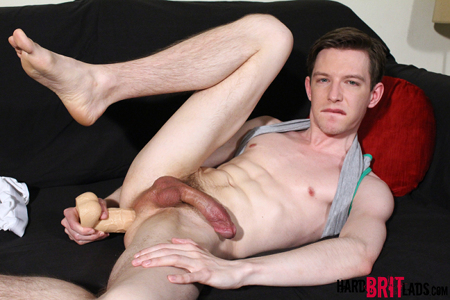 Hung twink fucking himself with a huge dildo.
