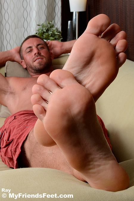 Hunky stud kicked back on the couch with his big bare feet exposed.
